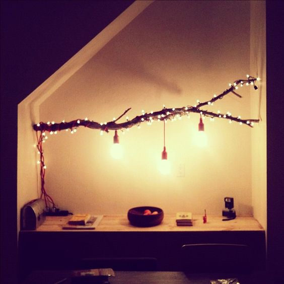 luminaria suspensa de galhos