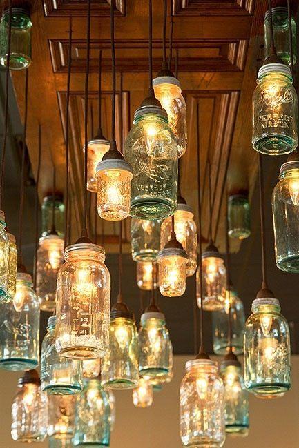 muitas luminraias em potes
