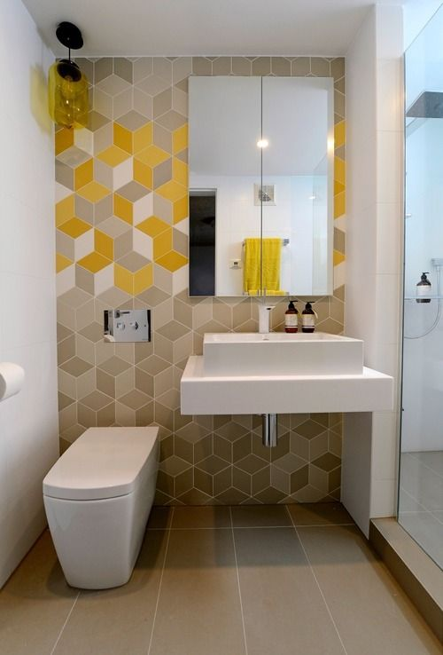 azulejos amarelos no banheiro