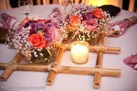 Arranjos de mesa para festa com bambus