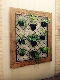 Artesanato em madeira de demolição com plantasArtesanato em madeira de demolição com plantas