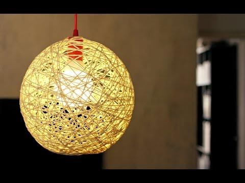 Luminária de barbante dourada