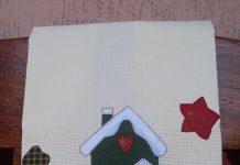 Patchwork em pano de prato com uma casa