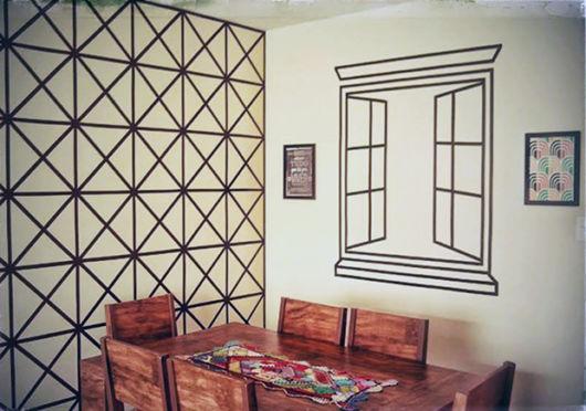 desenhos na parede feitos com fita