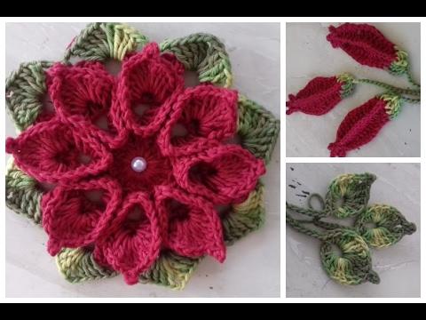 Flores de crochê com folhas e perolas