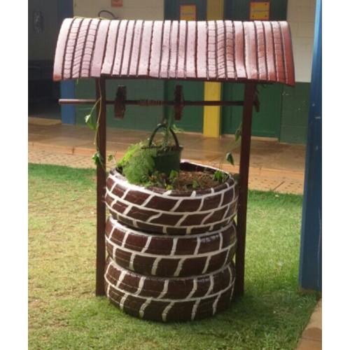 Poço para jardim com pneus