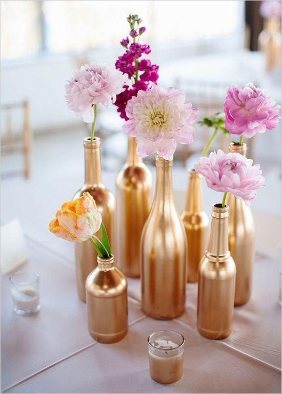 Arranjos de mesa bodas de ouro com flores