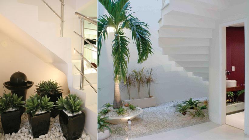 Jardim de inverno sob a escada com flores