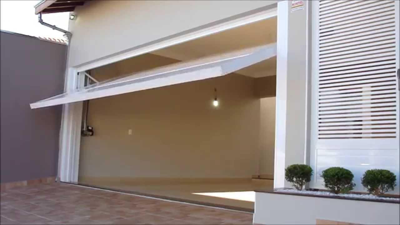 Portão de alumínio abertura para cimaa