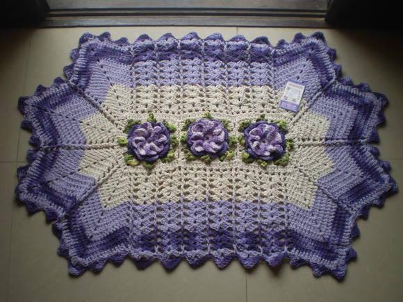 tapete de croche com flores caracol