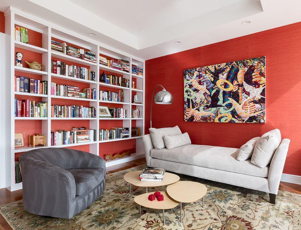 Parede com tons de vermelho na sala de estar
