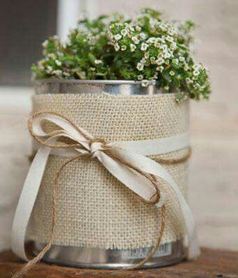 barbante e flores na lata para leite