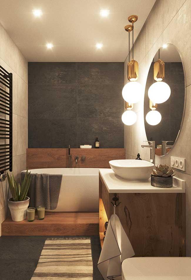 luzes redondas decorando o banheiro