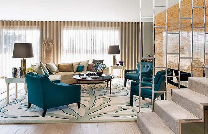 Poltronas em azul petroleo na sala de estar