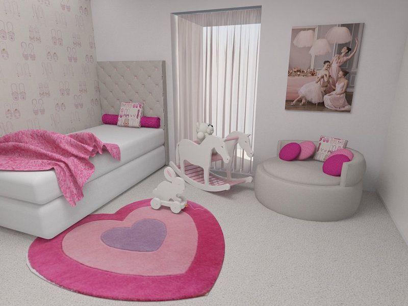 Quarto branco com um tapete rosa em forma de coração e almofadas