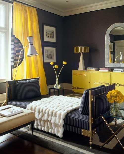 Quartos amarelos com cama em preto