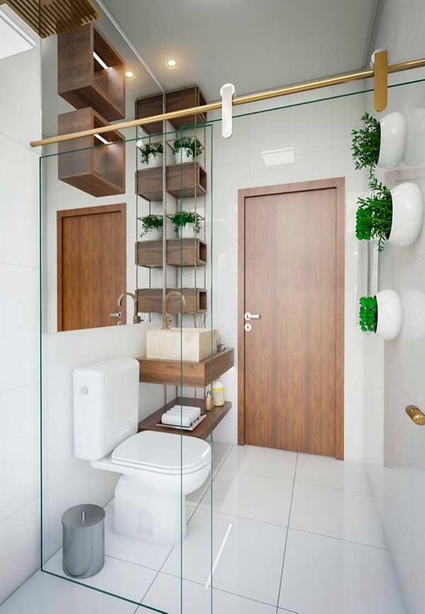Banheiro com parede branca em ceramica