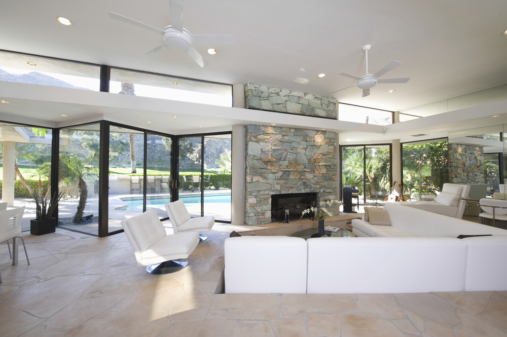 Porta de vidro sanfonada para a sala grande