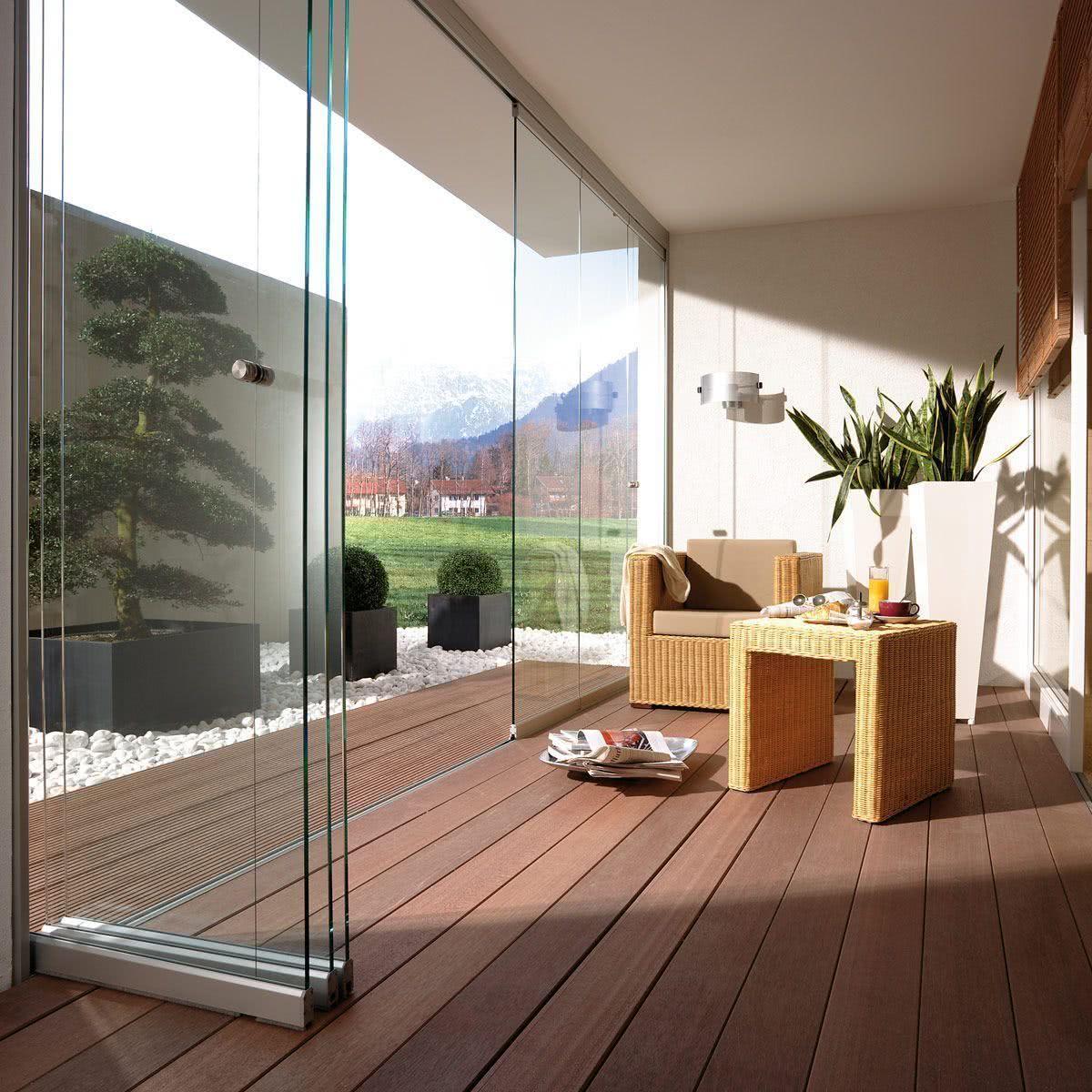 porta de vidro sanfonada para a sala