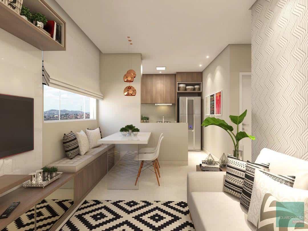 Cozinha americana com sala simples e sofá branco