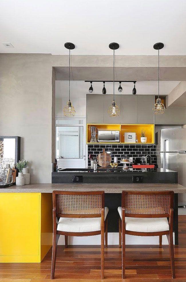 Cozinha no modelo americano um balcao em granito preto