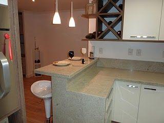 cozinha americana com balcão em granito
