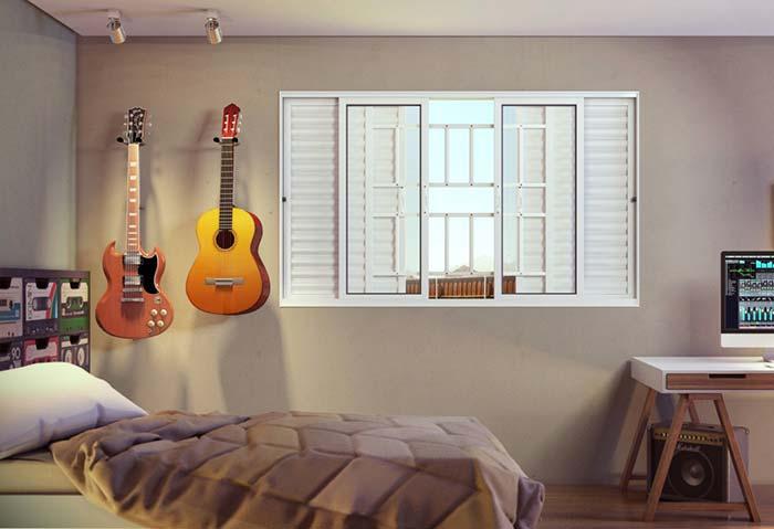 janela com 4 folhas de aluminio com grade externa