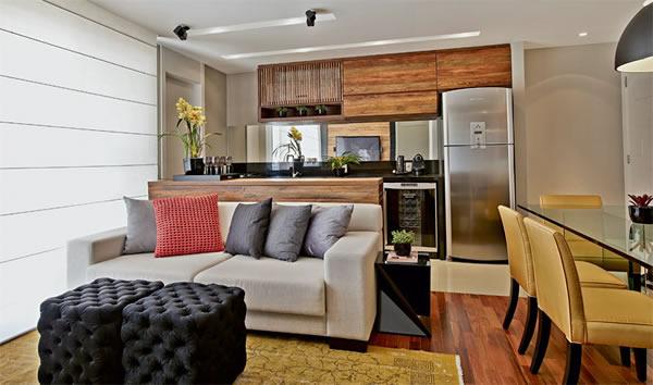 visualizando uma sala pequena com uma cozinha no modelo americano
