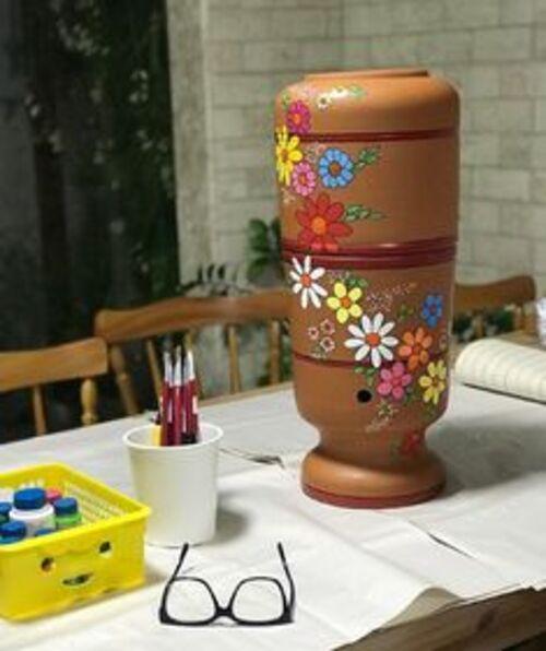 Enfeite de flores para garrafão de água